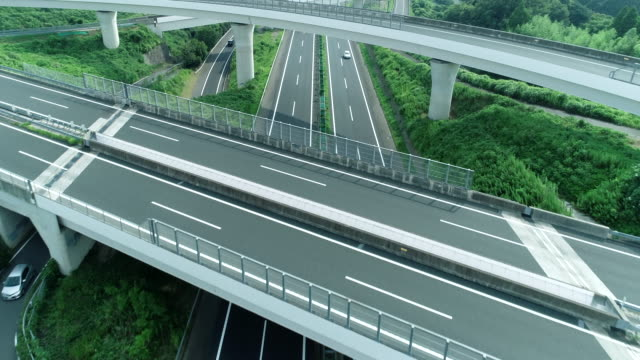 aerial view of multiple lane highway in nature - バイパス点の映像素材/bロール