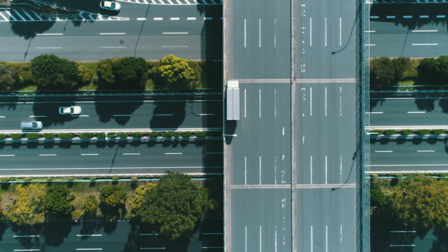 aerial view of multiple lane highway in nature - 移動中点の映像素材/bロール