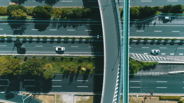 aerial view of multiple lane highway in nature - 交通輸送点の映像素材/bロール