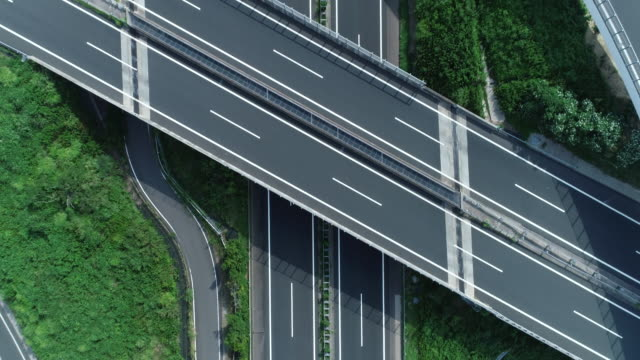 aerial view of multiple lane highway with nature - highway stock videos & royalty-free footage