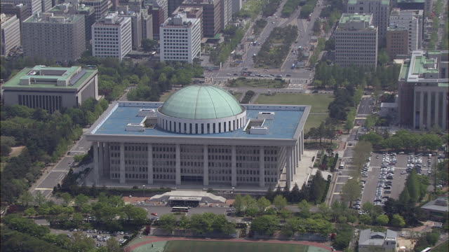Aerial view of National Assembly Building and pull out to reveal Yeouido-dong area