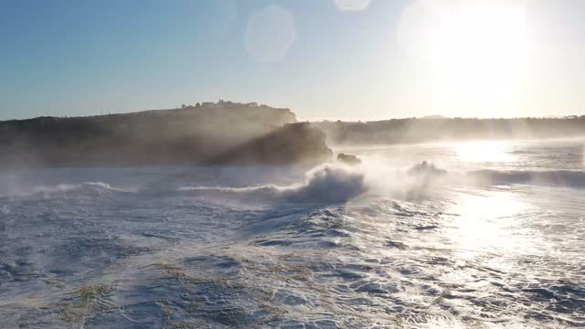 aerial view of nazaré during the surfing season with the largest waves on september 2020. nazaré is a municipality located in the oeste region and... - awe stock videos & royalty-free footage