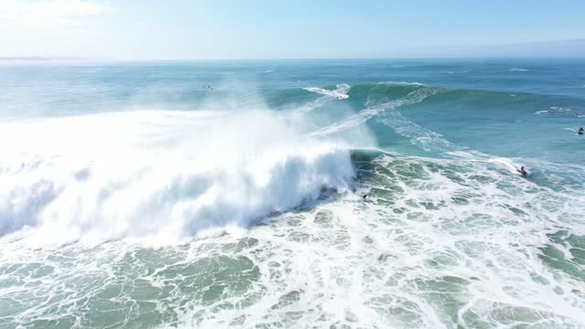 aerial view of nazaré during the surfing season with the largest waves in september 2020. nazaré is a municipality located in the oeste region and... - surf stock videos & royalty-free footage