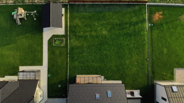 aerial view of neat backyards of new modern homes - landscaped stock videos & royalty-free footage