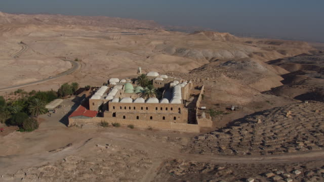 aerial view of nebi musa mosque, judean desrt, west bank, believed to be the tomb of moses. - israel stock-videos und b-roll-filmmaterial