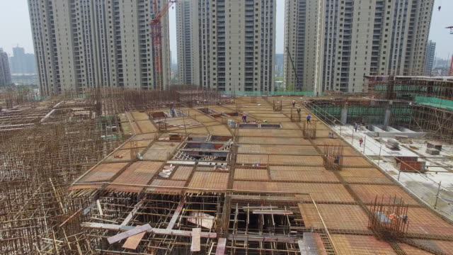 aerial view of new construction site in hangzhou. 4k - concrete stock videos & royalty-free footage