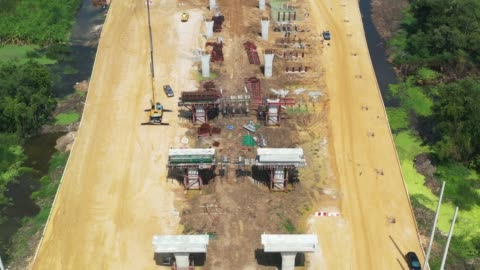 aerial view of new highway under construction - bridge built structure stock videos & royalty-free footage