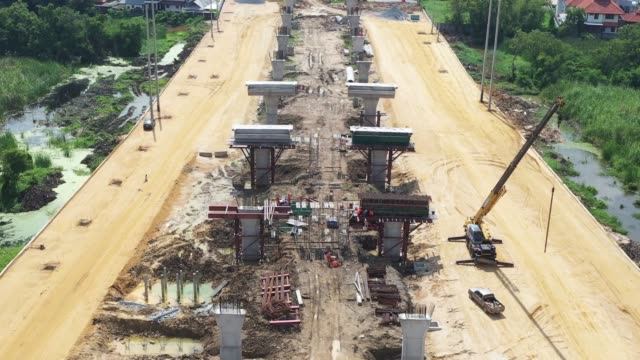 aerial view of new highway under construction - roadworks stock videos & royalty-free footage
