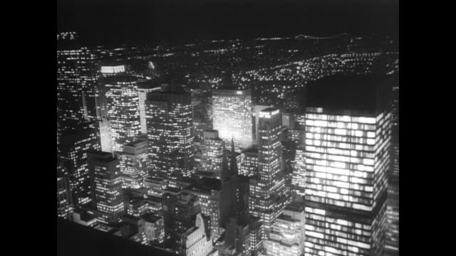 aerial view of new york city at night / governor nelson rockefeller and mayor robert wagner attend opening ceremony / men shake hands with cardinal... - 1965 stock videos & royalty-free footage