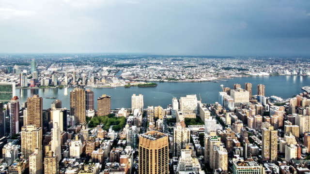 aerial view of new york city - river east stock videos & royalty-free footage