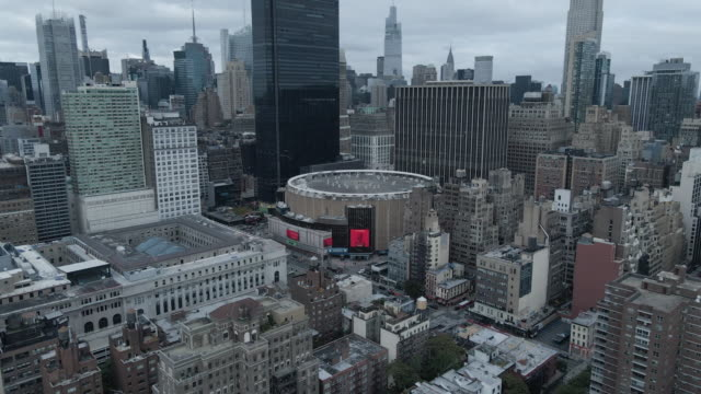 aerial view of new york city's madison square garden on an overcast afternoon - new york city penn station stock videos & royalty-free footage