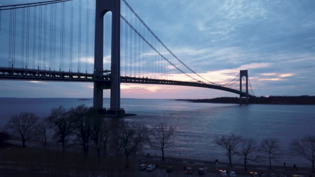 aerial view of new york city's verrazano bridge at dusk - staten island stock videos and b-roll footage