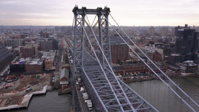 aerial view of new york's williamsburg bridge - williamsburg bridge stock videos and b-roll footage