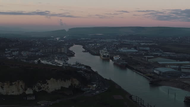 """aerial view of newhaven port at dusk. british fishermen aboard their boat """"about time"""" in the english chanel, fishing for a variety of breeds... - fishing industry stock videos & royalty-free footage"""