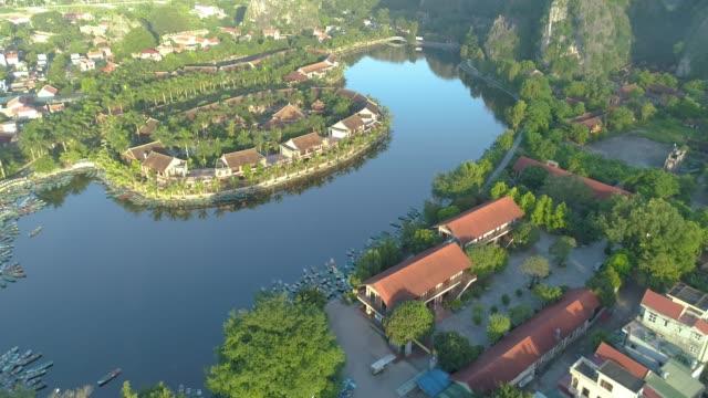 vídeos de stock, filmes e b-roll de aerial view of ninh binh region, trang an tam coc tourist attraction - ponto de referência natural
