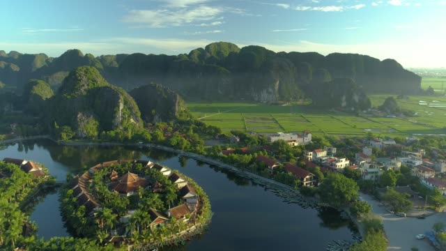 aerial view of ninh binh region, trang an tam coc tourist attraction - village点の映像素材/bロール