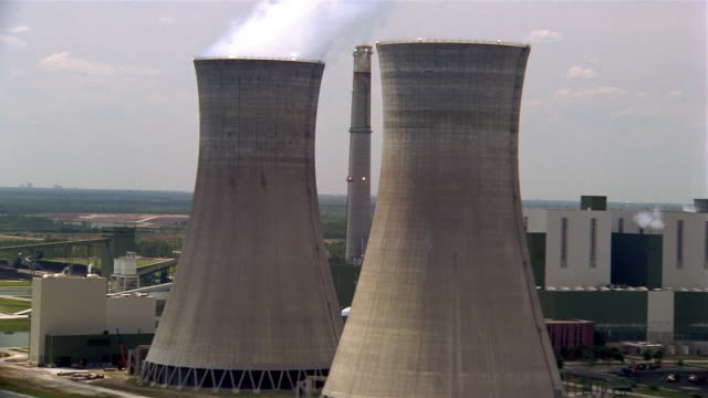 1996 aerial view of nuclear power plant with smokestacks / florida - nuclear power station stock videos & royalty-free footage