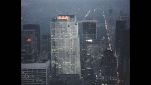 1985 aerial view of nyc - rockefeller center video stock e b–roll