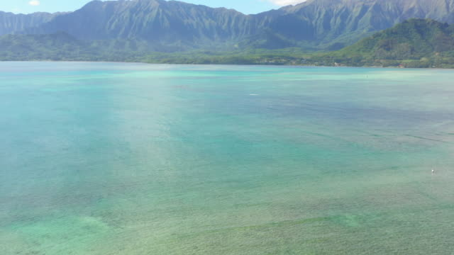 aerial: view of oahu and the beautiful ocean from chinaman's hat, oahu, hawaii - big island hawaii islands stock videos & royalty-free footage