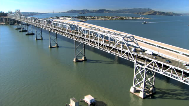 aerial view of oakland bay bridge construction america - bay of water stock videos & royalty-free footage