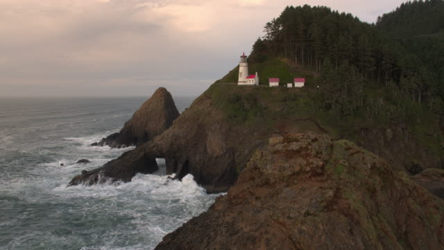 aerial view of ocean and cliffs at heceta head lighthouse - heceta head stock videos & royalty-free footage