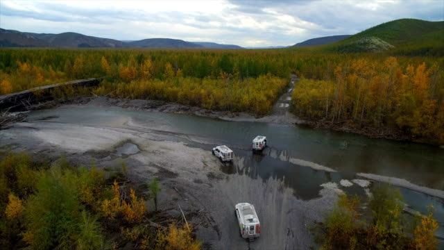 aerial view of off-road vehicle crossing the river - wearable camera stock videos & royalty-free footage