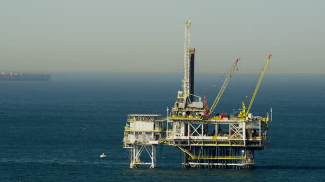 aerial view of offshore gas drilling pacific ocean - gas stock videos & royalty-free footage