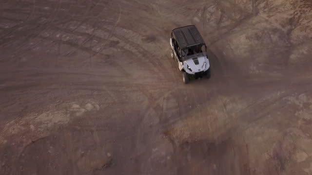 aerial view of ohv driving through the frame - 探求点の映像素材/bロール