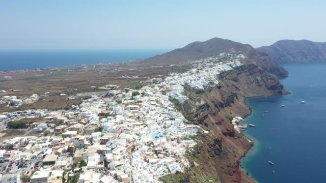 aerial view of oia, santorini, greece - santorini stock videos and b-roll footage