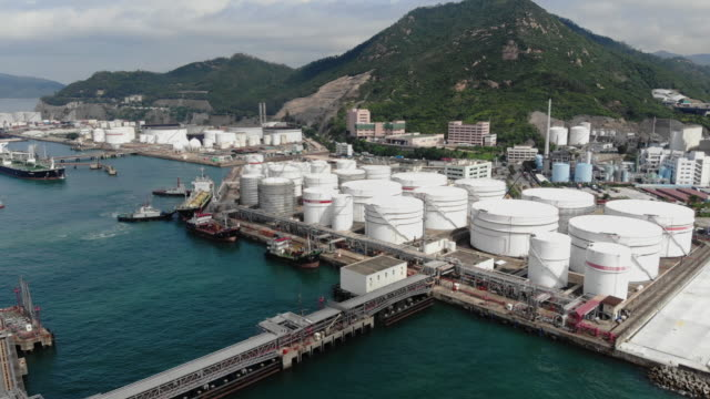 4k: aerial view of oil refinery factory in hong kong. - oil tanker stock videos and b-roll footage