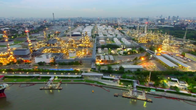 aerial view of oil refinery in the twilight - industrial equipment stock videos & royalty-free footage