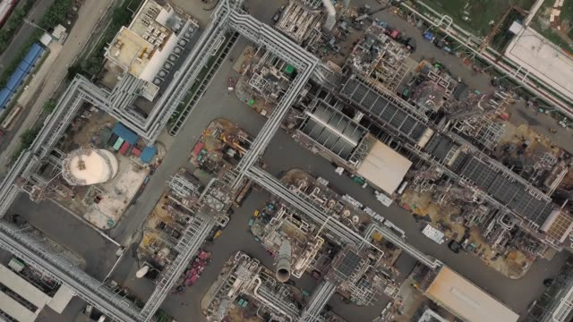 aerial view of oil refinery plant - fuel storage tank stock videos and b-roll footage
