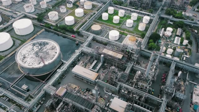 aerial view of oil refinery plant - storage tank stock videos & royalty-free footage