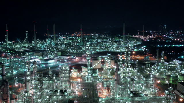 aerial view of oil refinery plant with storage tank - boiler stock videos & royalty-free footage