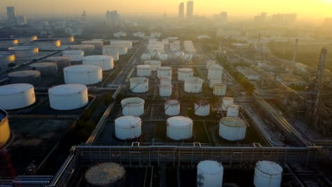 4k aerial view of oil refinery plant with storage tank - industry stock videos & royalty-free footage