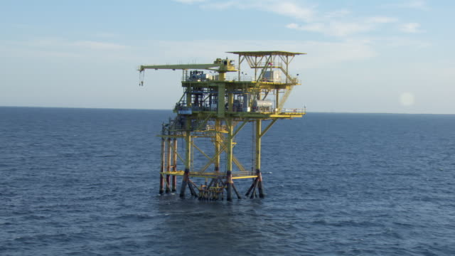 aerial view of oil rig platform in in the gulf of mexico off the coast of north padre island, texas. - gulf of mexico stock videos & royalty-free footage
