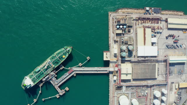 aerial view of oil tanker in industrial port at unloading of bulk contents in tsing yi - harbor stock videos & royalty-free footage