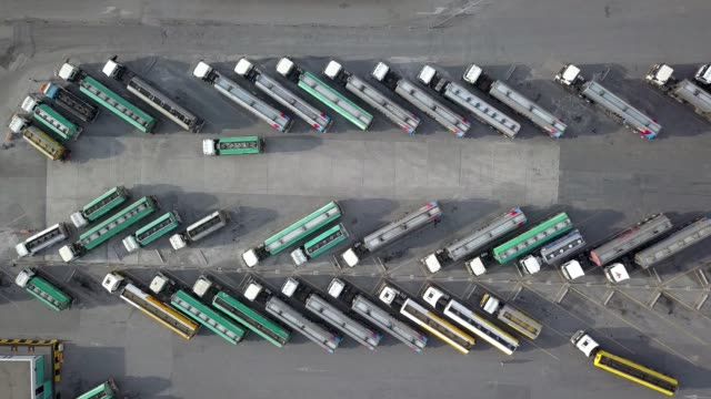 aerial view of oil trucks are parked in the parking lot waiting to transport the oil. - 鉄点の映像素材/bロール