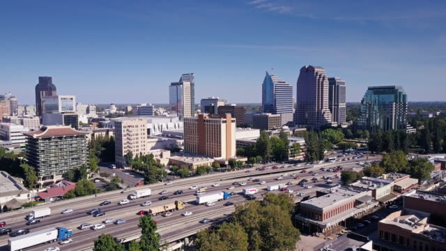 aerial view of old and new sacramento - autostrada interstatale americana video stock e b–roll