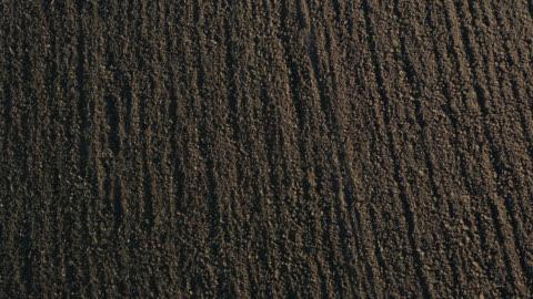 vídeos y material grabado en eventos de stock de aerial view of on a plowed field - campo arado