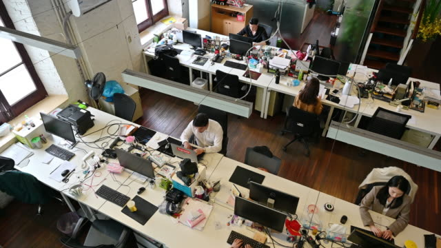 aerial view of open plan creative business office in shanghai - small office stock videos & royalty-free footage
