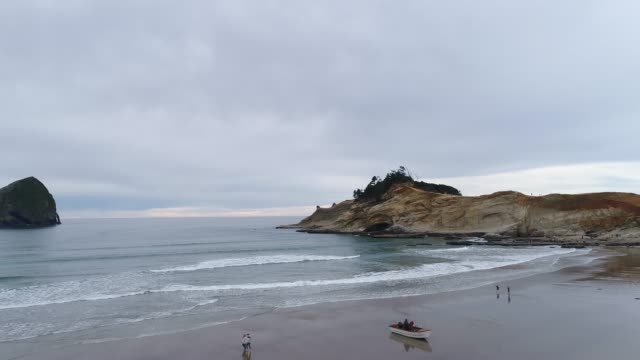 aerial view of oregon beach on an overcast evening - oregon coast stock videos & royalty-free footage