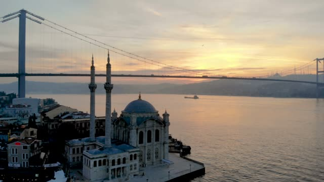aerial view of ortakoy mosque and bosphorus bridge - ortakoy mosque stock videos and b-roll footage