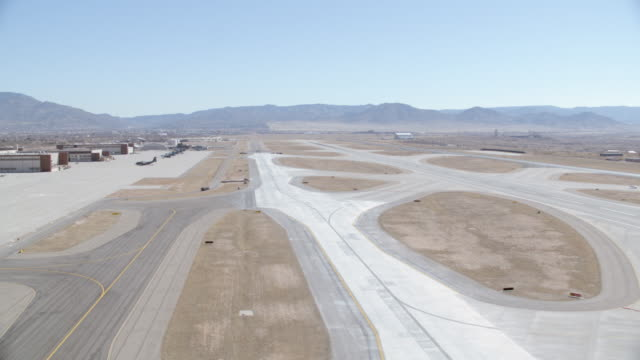 aerial view of osprey chopper base at airport with mountains in background. - runway stock videos & royalty-free footage