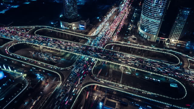 t/l aerial view of overpass and city traffic at night / beijing, china - chaos stock videos & royalty-free footage