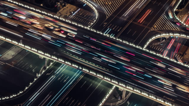 t/l zo aerial view of overpass and city traffic at night / beijing, china - light trail stock videos & royalty-free footage