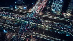 T/L PAN Aerial View of Overpass and City Traffic at Night / Beijing, China