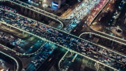 T/L WS PAN Aerial View of Overpass and City Traffic at Night / Beijing, China