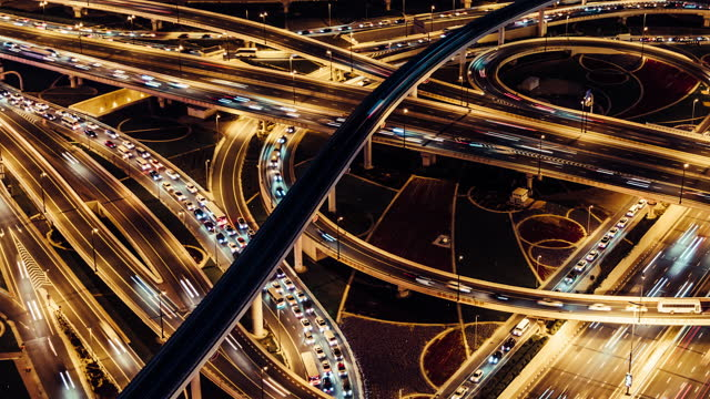t/l tu aerial view of overpass and city traffic at night / dubai, uae - fast motion stock videos & royalty-free footage