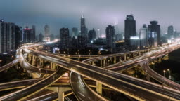 T/L ZO Aerial View of Overpass and City Traffic at Night / Shanghai, China